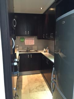 Neat Kitchen with fridge, stove, oven, dishwasher and lots of storage