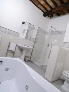 Bathroom with whirlpool bath & shower in Luxury First floor split level Apartment