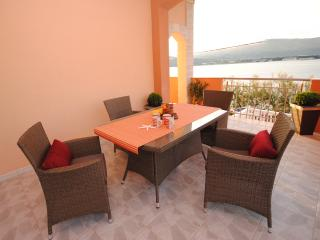 Two terrace two bedroom apartment at seafront, Arbanija