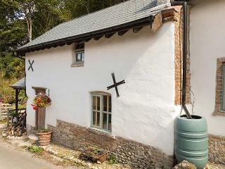 THE OLD DAIRY, semi-detached, en-suite, woodburning stove, parking, garden, in D