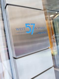 West 57th Street Sign at front entrance to building.