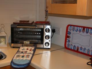 The small kitchen is compact but has everything you'll need.  Countertop cooker, kettle, toaster etc