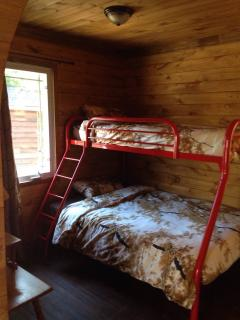 Bunk bed in the bunkie ( double on the bottom and single on top )