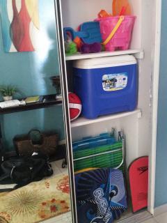 beach gear in entryway closet