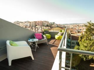 Sunny rooftop terrace panoramic view Lisbon