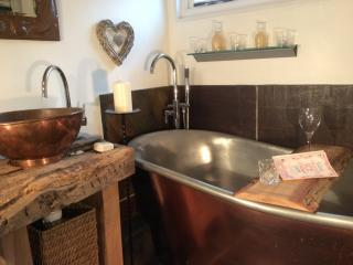 Relax and unwind in our copper bathroom with a bath big enough for 2!