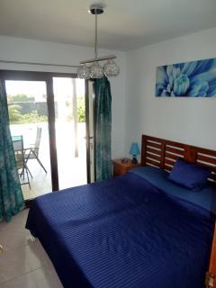 Bedroom 3 with doors to the terrace