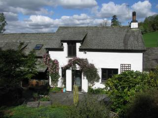 Rear of the detached cottage,  conversion, windows to lounge and 3rd bedroom