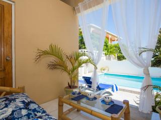 Savour a Jamaican Blue Mountain coffee overlooking the tropical pool