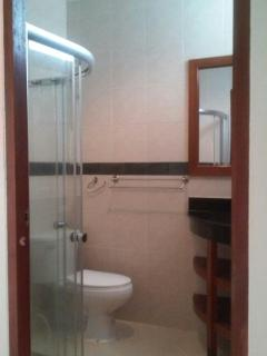 En suite with the shower in main bedroom .