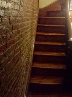 Exposed brick in our entry hallway and