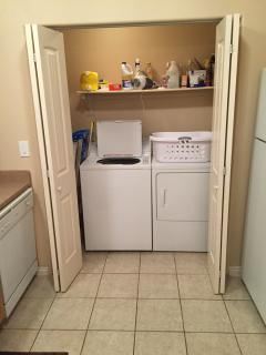 Brand New Washer and Dryer Located Next to Kitchen