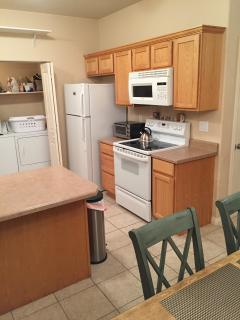 Kitchen Offers Modern Conveniences, including Stovetop, Oven, Microwave and Refigerator
