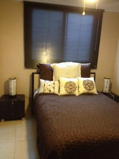 Master bedroom queen bed, air conditioner, 2 lamps ceiling fan and Wall mounted 32 Cable TV