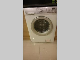 Unit is equipped with washer dryer.