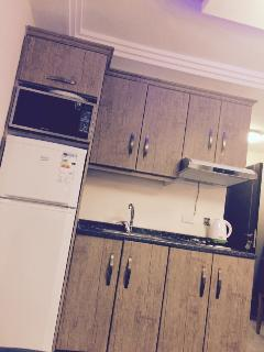 Kitchen /microwave/stove cook/fridge n freezer /and all serving and cooking tools included .