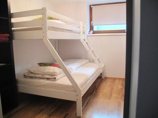 Second bedroom with room for 2 adults or 3 children.