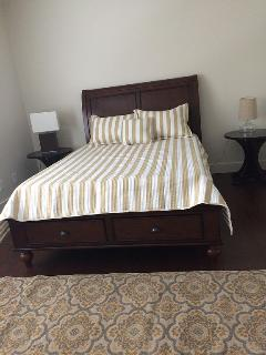 New queen bed with new mattress and linens