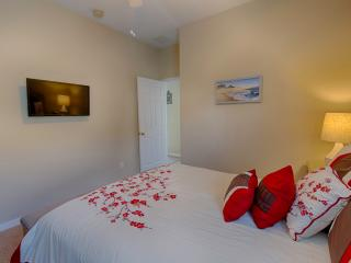 Downstair Queen Bedroom which is tastefully furnished and decorated with ceiling fan  and TV