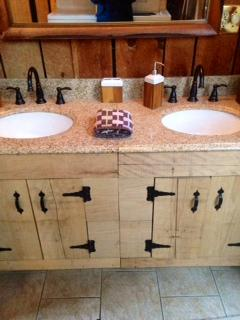 Handmade cabinets with double granite sinks in master bathroom