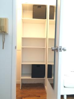 Huge closet with hanging racks and shelf space