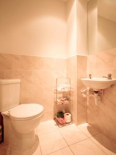 A useful downstairs Wc located by the front door- perfect for kicking off sandy shoes after a walk!