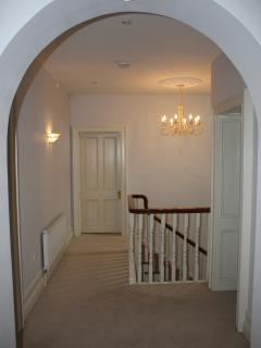 Upstairs, the wide corridor spaces provide a vision of the ample luxurious bedrooms.