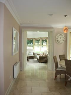 On entering the kitchen, you can go through to the naturally-lit sun lounge and surrounding garden.