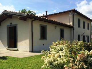 The spacious detached Villa Pianacci with doors leading to garden and private pool