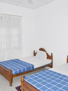 Twin room with two single beds and luxury thick mattresses.