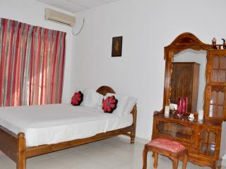 Master bedroom with air conditioning and king-size bed with luxury thick mattress.