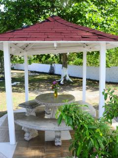 Relax under our Gazebo and enjoy our fruited gardens
