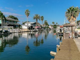 Fish & Boat at a Rockport Canal House with Private Dock