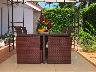 The Outstanding Beauty of our Secret Gardens Rattan table and chair can seat up to 8 people.