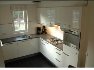 Modern kitchen with microwave, dishwasher etc.