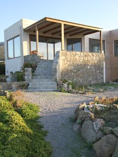 Large shaded terrace overlooking the garden and the sea