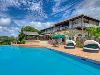 Sugar Mill House - Colonial style waterfront Villa with huge Infinity Pool