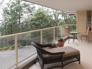 Large balcony with forest views