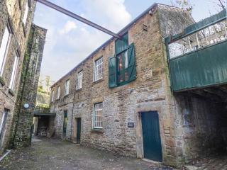 THE OLD WORKSHOP next to Grade II* listed mill, near river in New Mills Ref