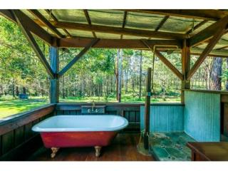 Handmade house on peaceful nut orchard by beach, Urunga