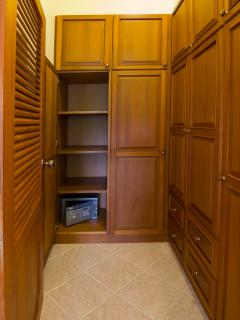 Dressing room with one cupboard door opened, showing the private electronic safe