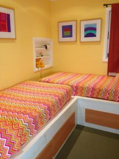 Kid's room is bright, sunny and cheerful. Perfect for getting a great rest before a day full of fun.