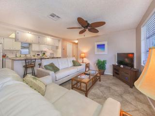 Cozy living room features a large flat screen TV with DVR and lots of HD channels