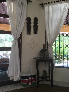 Art corner decorated with simple yet elegant African art pieces.