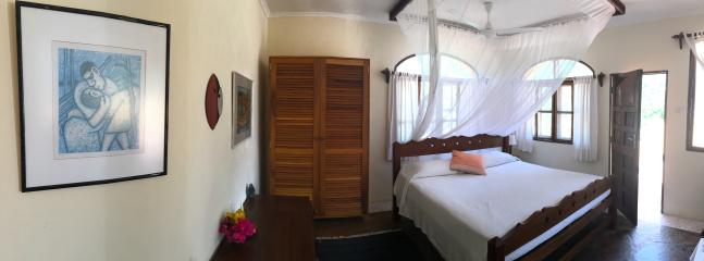 The Colobus bedroom opens up onto the sun deck with panoramic views of the ocean.