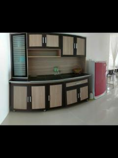 kitchen cabinet with cooking utensils