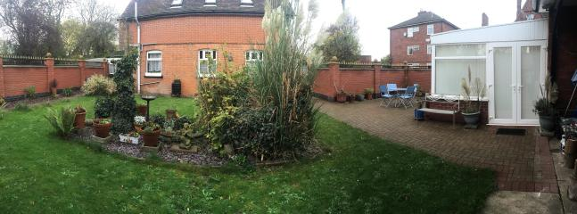 Private secure rear garden with patio and BBQ area.