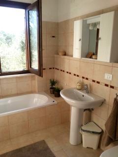 Family bathroom, with bath tub.