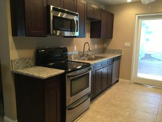 Full kitchen equipped with kitchen electrics, flatware, cookware, silverware provided