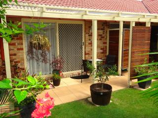 Private, sheltered garden access to elegant Queen room